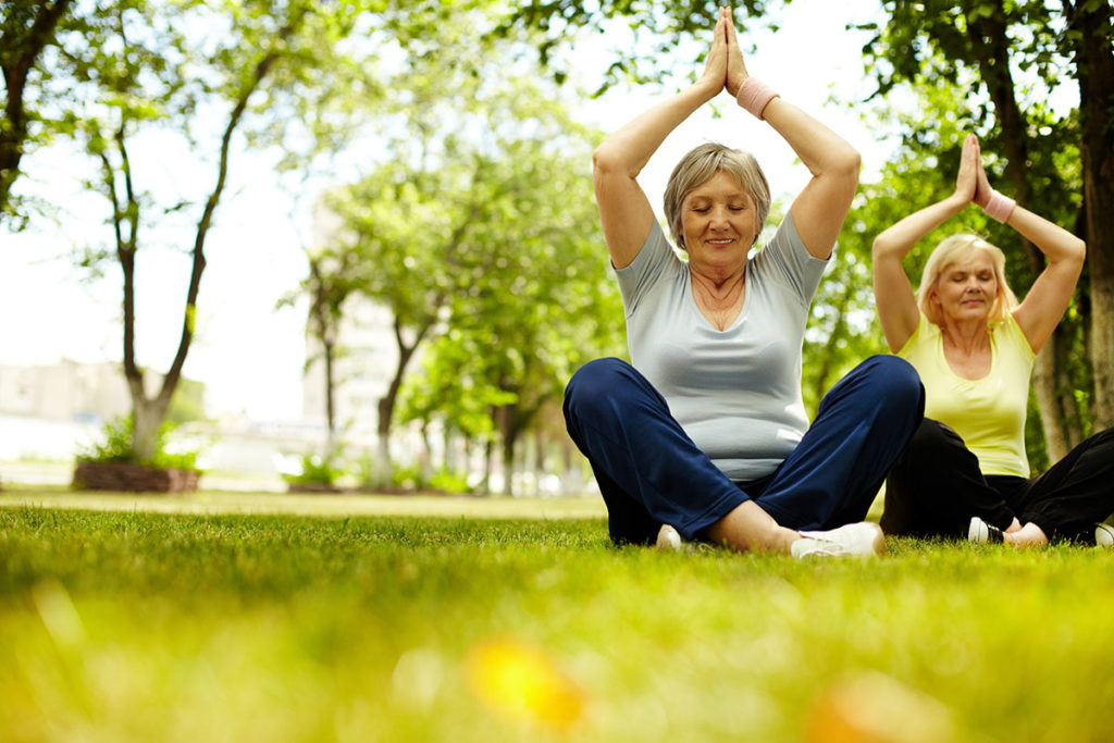 elderly people doing yoga